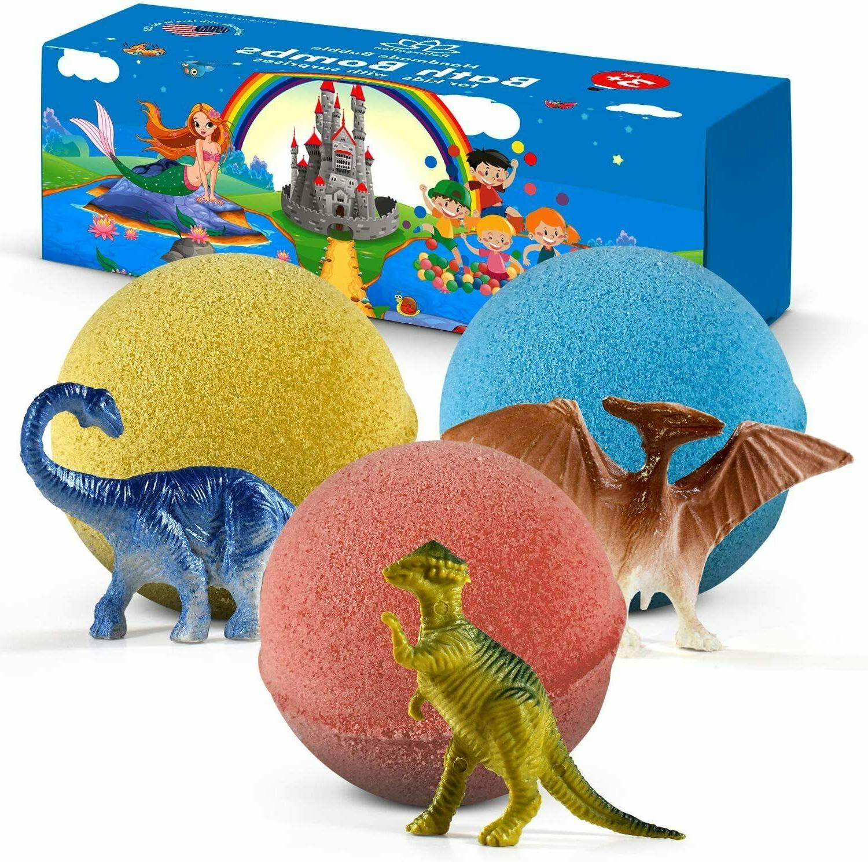 3 bath bombs with dinosaurs toys inside